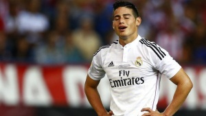 Real Madrid's James Rodriguez reacts after missing a chance to score a goal against Atletico Madrid during their Spanish Super Cup second leg soccer match at Vicente Calderon stadium in Madrid August 22, 2014.  REUTERS/Sergio Perez/Files