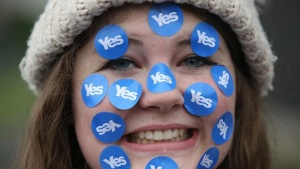 "A women wears stickers on her face on a ""short walk to freedom"" march in Edinburgh, Scotland September 18, 2014. REUTERS/Paul Hackett"