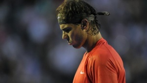Rafael Nadal of Spain reacts during a match in Melbourne January 26, 2011. REUTERS/Paul Crock/Pool/Files