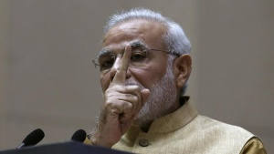 India's Prime Minister Narendra Modi gestures as he speaks during the launch of 'Make in India' campaign in New Delhi September 25, 2014. REUTERS/Adnan Abidi/Files