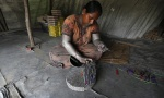 A worker makes firecrackers at a factory for the upcoming Diwali festival on the outskirts of Ahmedabad October 10, 2014. REUTERS/Amit Dave