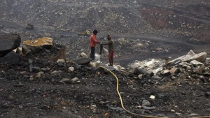Workers drill at an open cast coal field at Dhanbad district in Jharkhand September 18, 2012. REUTERS/Ahmad Masood/Files