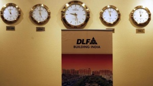 A banner of real estate firm DLF Ltd. Is seen during the listing ceremony of DLF Ltd. at the Bombay Stock Exchange in Mumbai July 5, 2007. REUTERS/Arko Datta/Files