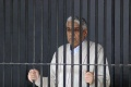 "Satguru Rampalji Maharaj, a self-styled ""godman"" is seen inside a police lock-up after his arrest, at Panchkula in Haryana November 20, 2014. REUTERS/Stringer"