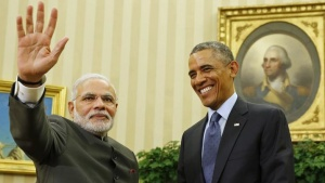 U.S. President Barack Obama smiles as he hosts a meeting with India's Prime Minister Narendra Modi in the Oval Office of the White House in Washington September 30, 2014. REUTERS/Larry Downing/Files