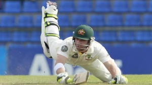 Australia's Phillip Hughes dives to complete a run during the first day of their second test cricket match against Sri Lanka in Kandy  September 8, 2011. REUTERS/Dinuka Liyanawatte (SRI LANKA - Tags: SPORT CRICKET)