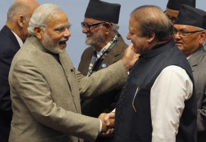 India's Prime Minister Narendra Modi (L) shakes hands with his Pakistani counterpart Nawaz Sharif (2-R) in front of Nepal's Prime Minister Sushil Koirala (C) during the closing session of 18th South Asian Association for Regional Cooperation (SAARC) summit in Kathmandu November 27, 2014. REUTERS/Niranjan Shrestha/Pool