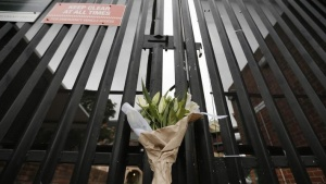 Flowers, left to honour Australian cricketer Phillip Hughes, rest against the gates of the Sydney Cricket Ground, November 27, 2014. REUTERS/Jason Reed