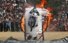 A policeman performs a stunt on his motorcycle during the Republic Day parade in Jammu January 26, 2015. REUTERS/Mukesh Gupta