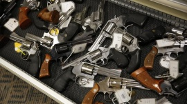 Handguns line the shelves in the gun library at the U.S. Bureau of Alcohol, Tobacco and Firearms National Tracing Center in Martinsburg, West Virginia December 15, 2015.    REUTERS/Jonathan Ernst