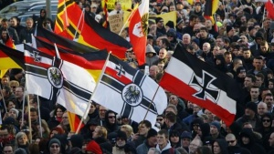 Supporters of anti-immigration right-wing movement PEGIDA take part in a demonstration march, in reaction to mass assaults on women on New Year's Eve, in Cologne, Germany, January 9, 2016. REUTERS/Wolfgang Rattay