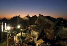 A 17-storey apartment building which collapsed after an earthquake is seen during sunset in Tainan, southern Taiwan, February 8, 2016. REUTERS/Tyrone Siu