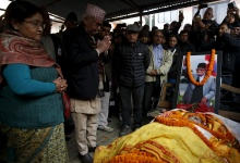 ATTENTION EDITORS - VISUAL COVERAGE OF SCENES OF INJURY OR DEATH. Nepalese Prime Minister Khadga Prashad Sharma Oli, also known as KP Oli, pays his respects to the late former Prime Minister Sushil Koirala in Kathmandu, Nepal, February 9, 2016.  REUTERS/Navesh Chitrakar
