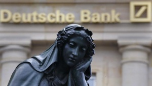 A statue is seen next to the logo of Germany's Deutsche Bank in Frankfurt, Germany, January 26, 2016. REUTERS/Kai Pfaffenbach