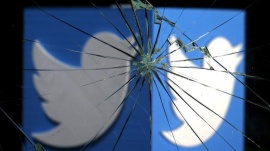 A 3D-printed Twitter logo is seen through broken glass, in this picture illustration taken February 8, 2016. REUTERS/Dado Ruvic/Illustration