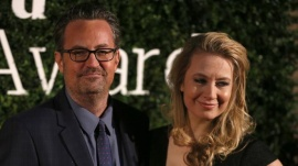 U.S. actor Matthew Perry and his companion pose for photographers at the Evening Standard British Film Awards in London, Britain February 7, 2016. REUTERS/Neil Hall