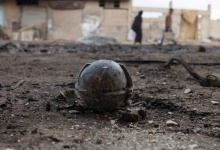 An unexploded cluster bomblet is seen along a street after airstrikes by pro-Syrian government forces in the rebel held al-Ghariyah al-Gharbiyah town, in Deraa province, Syria February 11, 2016. REUTERS/Alaa Al-Faqir