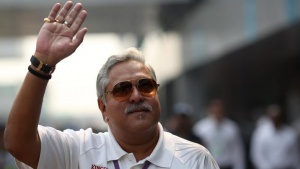 Vijay Mallya waves in the paddock at the Buddh International Circuit in Greater Noida, on the outskirts of New Delhi, October 27, 2012. REUTERS/Ahmad Masood/Files