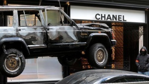 A car torched during a shop robbery at the Chanel shop on the Avenue Montaigne is lifted to be removed in Paris, France, April 28, 2016. REUTERS/Christian Hartmann