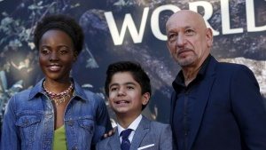 "Cast members Lupita Nyong'o, Neel Sethi (C) and Ben Kingsley pose at the premiere of ""The Jungle Book"" at El Capitan theatre in Hollywood, California April 4, 2016. REUTERS/Mario Anzuoni"