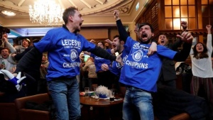 Britain Football Soccer - Leicester City fans watch the Chelsea v Tottenham Hotspur game in pub in Leicester - 2/5/16Leicester City fans celebrate Chelsea's second goalReuters / Eddie Keogh/ Livepic