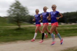 Estonia's Olympic team female marathon runners triplets (L-R) Lily, Liina and Leila Luik run during a training session in Tartu. REUTERS/Ints Kalnins