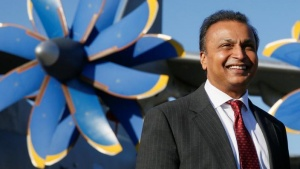 Anil Ambani, chairman of the Reliance Anil Dhirubhai Ambani Group, smiles in front of an An-70 aircraft during a visit to Antonov aircraft plant in the village of Gostomel, outside Kiev, Ukraine, April 27, 2016.  REUTERS/Valentyn Ogirenko/Files