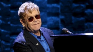 "Singer Elton John performs at the Hillary Victory Fund ""I'm With Her"" benefit concert for U.S. Democratic presidential candidate Hillary Clinton at Radio City Music Hall in the Manhattan borough of New York City, March 2, 2016. REUTERS/Mike Segar/Files"