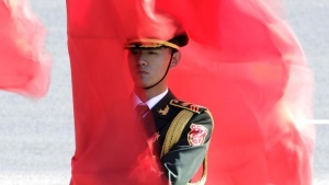 A soldier from the honour guards holding a red flag stands during a welcoming ceremony for Germany's Chancellor Angela Merkel outside the Great Hall of the People in Beijing, China, October 29, 2015. REUTERS/Jason Lee/File Photo