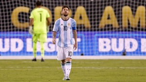 Jun 26, 2016; East Rutherford, NJ, USA; Argentina midfielder Lionel Messi (10) reacts after missing a shot during the shoot out round against Chile in the championship match of the 2016 Copa America Centenario soccer tournament at MetLife Stadium. Chile won. Mandatory Credit: Adam Hunger-USA TODAY Sports