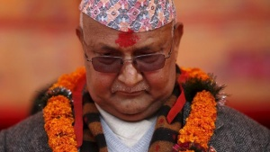 Nepal's Prime Minister Khadga Prasad Sharma Oli, also known as KP Oli, observes a minute of silence for earthquake victims during an event organised to mark the 18th National Earthquake Safety Day and the official launch of earthquake reconstruction efforts in Bungamati village, Nepal January 16, 2016. REUTERS/Navesh Chitrakar/Files