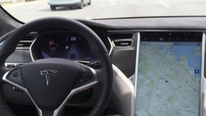 The interior of a Tesla Model S is shown in autopilot mode in San Francisco, California, U.S., April 7, 2016.   REUTERS/Alexandria Sage/Files