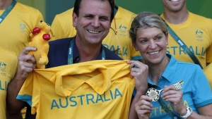 Rio's mayor Eduardo Paes and Kitty Chiller, Chef de Mission for Australia, pose for a photo next to members of the Australian delegation at the Rio 2016 Olympic Games, during a welcome ceremony he arranged for them at the Olympic village in Rio de Janeiro, Brazil, July 27, 2016.   REUTERS/Edgard Garrido