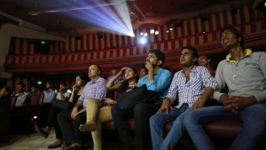 "Cinema goers watch Bollywood movie ""Dilwale Dulhania Le Jayenge"" (The Big Hearted Will Take the Bride), starring actor Shah Rukh Khan, inside Maratha Mandir theatre in Mumbai December 12, 2014.REUTERS/Danish Siddiqui/Files"