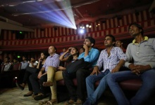 """Cinema goers watch Bollywood movie """"Dilwale Dulhania Le Jayenge"""" (The Big Hearted Will Take the Bride), starring actor Shah Rukh Khan, inside Maratha Mandir theatre in Mumbai December 12, 2014. REUTERS/Danish Siddiqui/Files"""