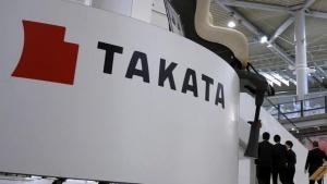 Visitors walk behind a logo of Takata Corp on its display at a showroom for vehicles in Tokyo, Japan, November 6, 2015. REUTERS/Toru Hanai/File Photo