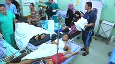 (GRAPHIC IMAGES) At least 15 die in shelling of Gaza school
