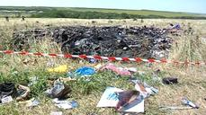 Experts start work at Ukraine crash site
