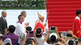 Pope Francis beatifies martyrs, visits disabled