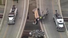 Tractor-trailer dangles over freeway edge