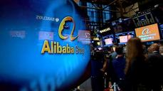 Alibaba soars but other techs falter; New Dow high