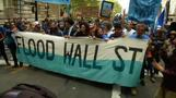 Climate change protesters march in New York's Financial District