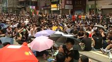 Hong Kong protesters defy police in push for democracy