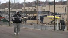 Ferguson simmers after night of protest violence