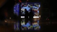 Asian markets rattled by oil price drop