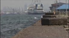 Sinking Jakarta embarks on seawall project