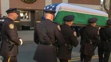 Mourners gather for slain New York policeman