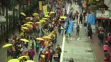 Pro-democracy protesters return to Hong Kong