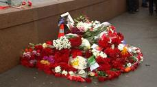 Russian mourners lay flowers at the spot where opposition leader was killed