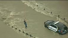 Police officer airlifted from Texas floodwater
